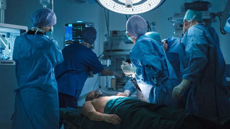Doctors Defibrillating Patient