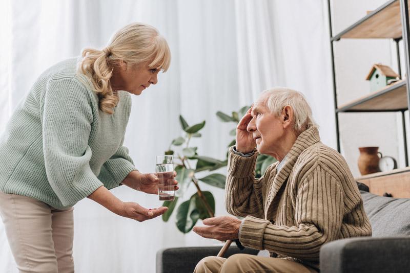 Elderly man taking medication for memory loss